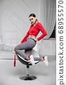 Beautiful woman wearing a a red blouse 68955570