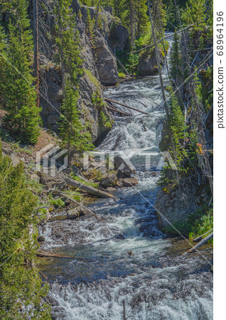 The beautiful Kepler Cascades Waterfall on the Firehole River. Southwestern Yellowstone National Park in the Rocky Mountains, Park County, Wyoming 68964196