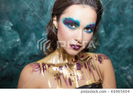 Young beautiful woman with creative make up 68965604
