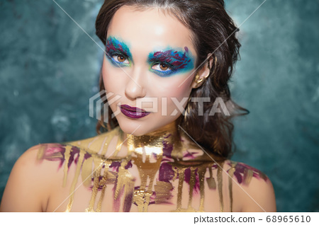 Young lovely woman with creative make up 68965610