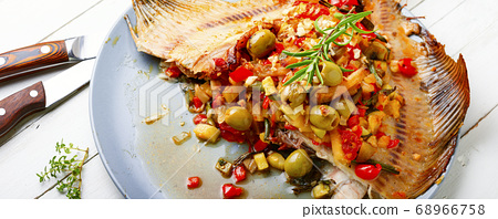 Flounder with vegetables on table 68966758