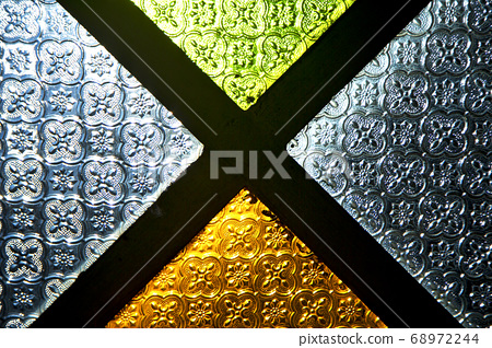 colorated glass and sun in morocco africa window 68972244
