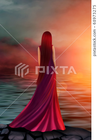 Beautiful girl in a long red dress in the rays of 68973275