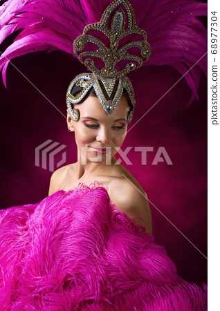 Beautiful Girl in carnival costume with pink 68977304