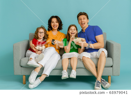 Happy loving family on bright color background. 68979041