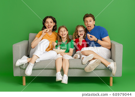 Happy loving family on bright color background. 68979044