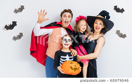 Happy family celebrating Halloween. 68979046