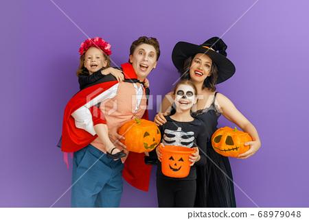Happy family celebrating Halloween. 68979048