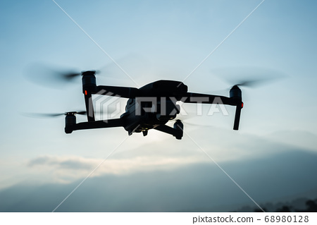 flying drone in the outdoor 68980128