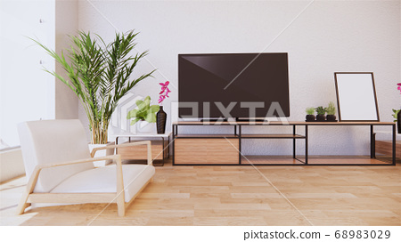 Armchair and tv cabinet on room white wall, 68983029