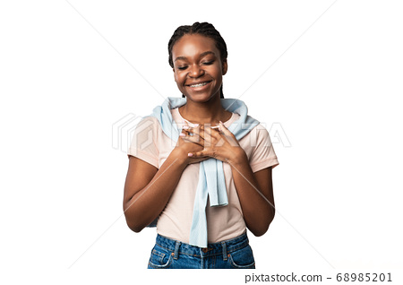 Black Woman Pressing Hands To Chest Expressing Gratitude, White Background 68985201