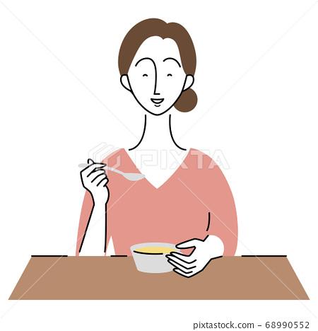 맛있게 식사를하는 여성 68990552