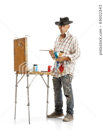 Artist, painter at work isolated on white studio background 69002843