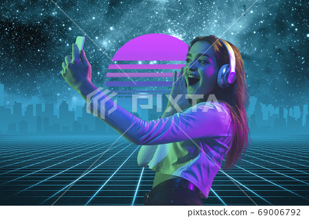 Synth wave and retro wave, vaporwave futuristic aesthetics. Woman with device in glowing neon style. 69006792