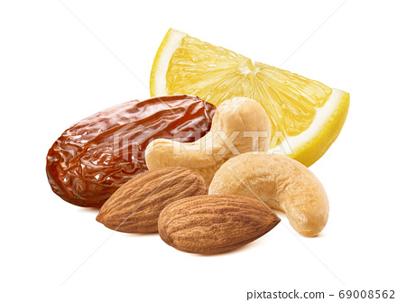Slice of lemon, date, cashew and almond nuts 69008562