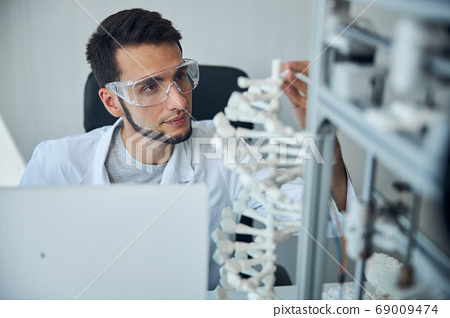 Medical student examining the 3D printed DNA model 69009474
