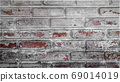 Close up of old brick surface with peeling of color, home interior repairing concept for background. 69014019