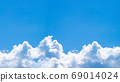 Blue sky and white fluffy cloud, empty space for copy, natural scene for background. 69014024