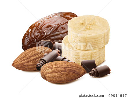 Banana slices, dates, almond nuts and chocolate pieces isolated on white background 69014617