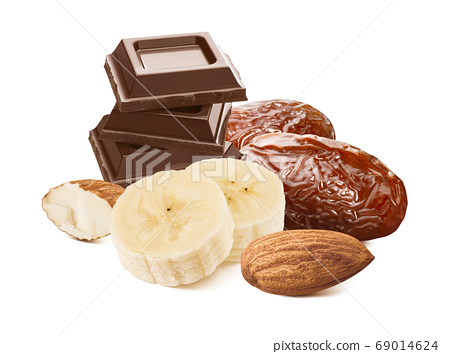 Banana slices, dates, almonds and milk chocolate isolated on white background 69014624
