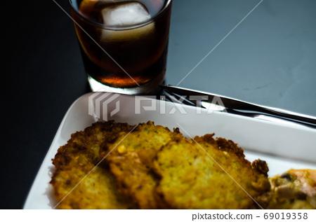 potato pancakes with spicy stew, delicious 69019358