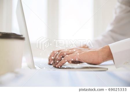 Close up image of businessman hands working computer laptop on desk in office room 69025333