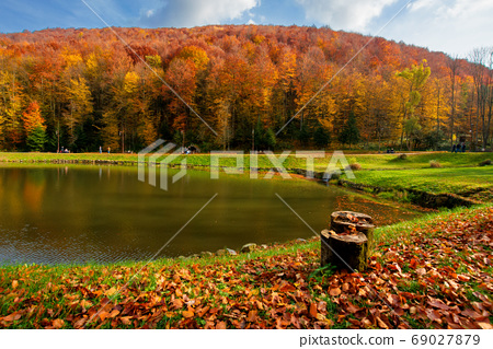 small lake in autumn park. forest on the hills in fall colors. g 69027879