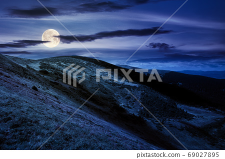 hills and valley of mountain landscape at night. clouds on the d 69027895