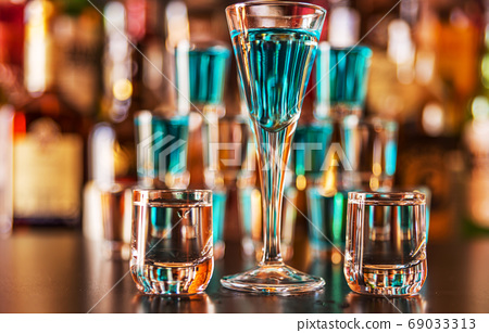 Traditional pure vodka in glasses on a black 69033313