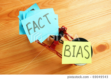 Scales with the words bias and facts. 69049543