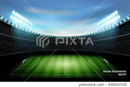 在日落的背景下照亮的足球場 69068599