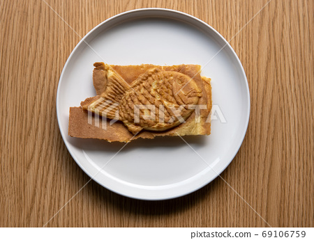 Taiyaki Japanese filled pastry on plate. 69106759