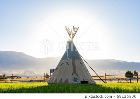 Morning view of the Native American Indian Tents Teepee 69125830