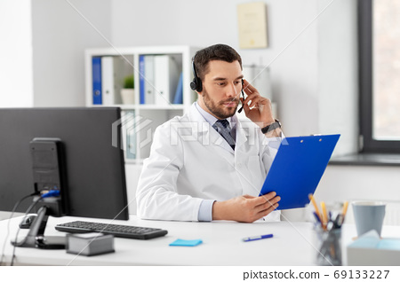 male doctor with headset and clipboard at hospital 69133227