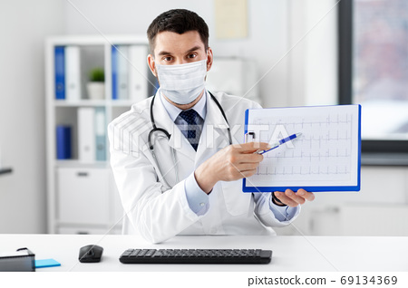 doctor with cardiogram having video call at clinic 69134369