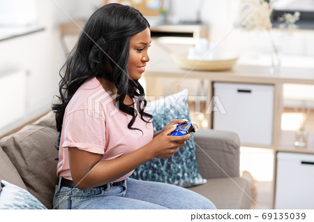 african american woman with gamepad playing game 69135039