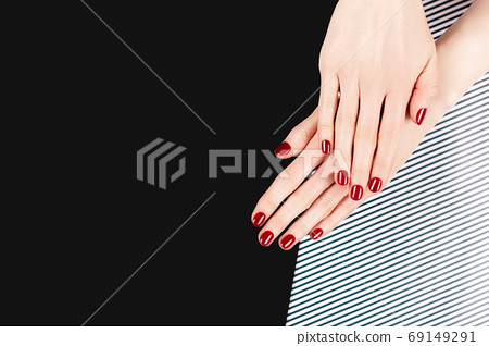 Woman hands with perfect classic manicure with red polish. 69149291