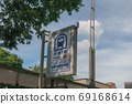 Kyoto Municipal Subway Tozai Line Kyoto City Hall front signboard and blue sky 69168614