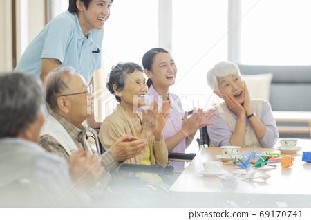 Senior women and senior men living in nursing homes 69170741