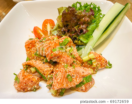 Spicy Salmon Salad (Laab Salmon) on the table 69172659