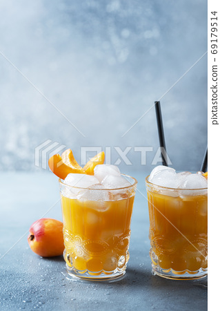 Summer juice with apricots and ice 69179514
