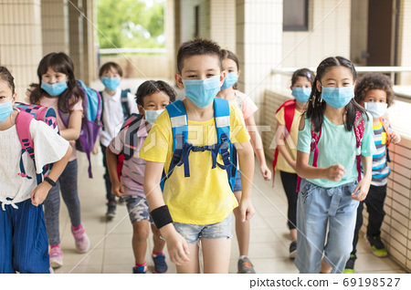 Group of children wearing  face mask back at school after covid-19 quarantine 69198527