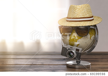 Tourism and travel concept. Globe with summer hat, sunglasses an 69199598