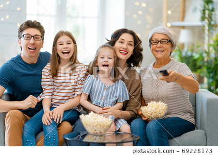 Happy family spending time together. 69228173