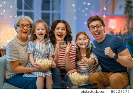 Happy family spending time together. 69228175