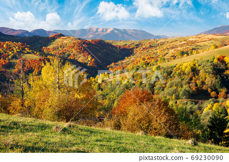 mountainous countryside scenery on a sunny day. beautiful rural 69230090