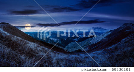 mountain landscape in autumn at night. dry colorful grass on the 69230101