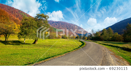 country road winding through the valley. wonderful autumn landsc 69230115