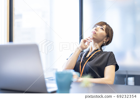 A woman who thinks about a better idea while creating a plan 69232354