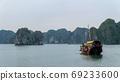 Cat Ba, Vietnam - November 19, 2019 : Boat cruising in Lan Ha Bay 69233600
